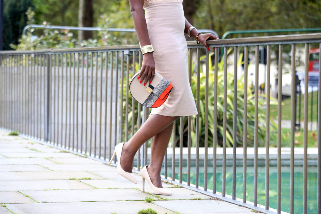 nude shoes and orange accent purse