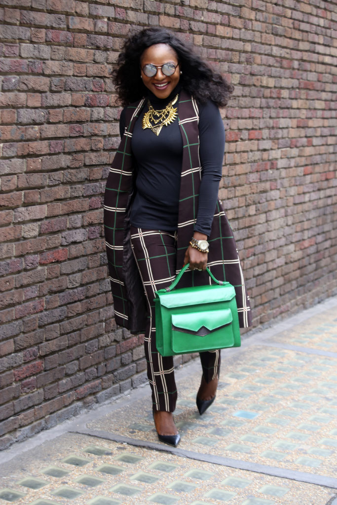 grid suit,black camisole,green bag