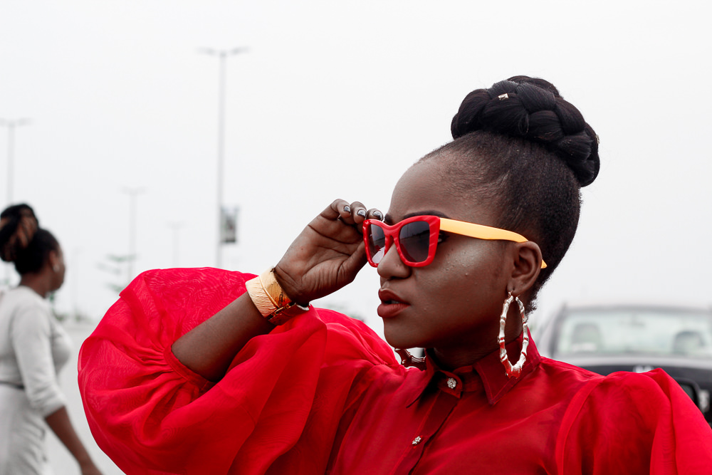 heineken lagos fashion and design week 2017 , what i wore ,all red outfit ,styling all red ,fashion week style , lfdw street style ,bubble sleeve shirt,straight leg pant , gucci fanny pack